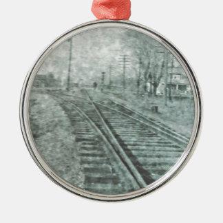 Untersuchen Sie die Vergangenheit Silbernes Ornament