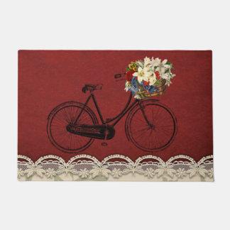 vélo rouge bienvenu de bicyclette de tapis de