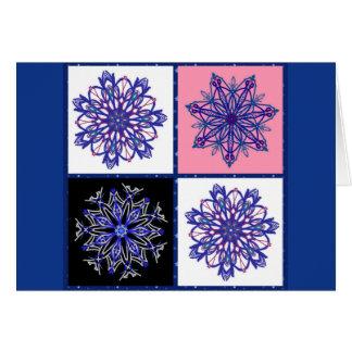 Vier extravagante Schneeflocken auf Blau Grußkarte