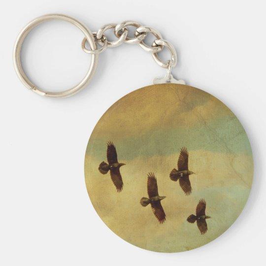 Vier Raben-Fliegen Schlüsselanhänger