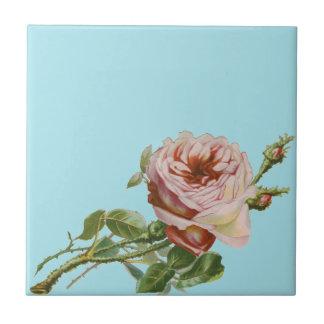 Vintage rosa Rose auf blassem Aqua Keramikkachel
