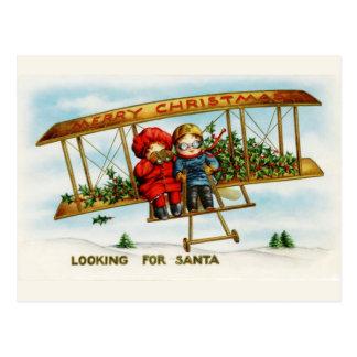 Vintage Weihnachtskinder, die nach Sankt suchen Postkarte