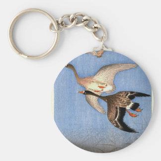 Vintager Druck der Fliegen-Gänse Schlüsselanhänger