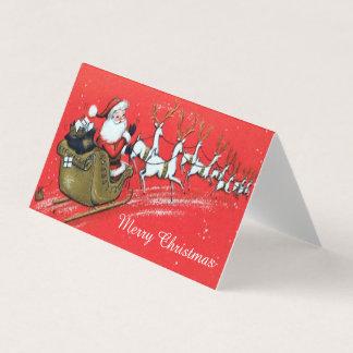 Vintager Weihnachtsmann auf seinem Sleigh mit Ren Karte