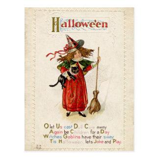 Vintages kleines Hexe-Mädchen Halloweens mit einer Postkarte