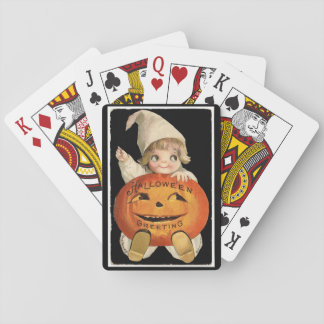 Vintages kleines Mädchen mit großem Spielkarten