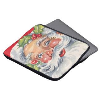 Vintages Weihnachten, lustiger Weihnachtsmann mit Laptopschutzhülle
