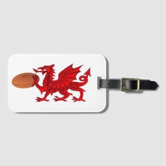 Waliser-Drache mit einem Rugbyball-Gepäckanhänger Gepäckanhänger