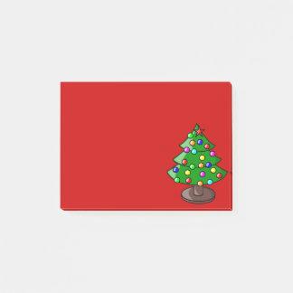 Weihnachtsbaum auf roter Post-Itanmerkung Post-it Klebezettel
