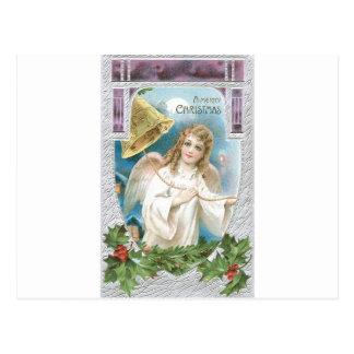 Weihnachtsengel, der eine Glocke schellt Postkarte