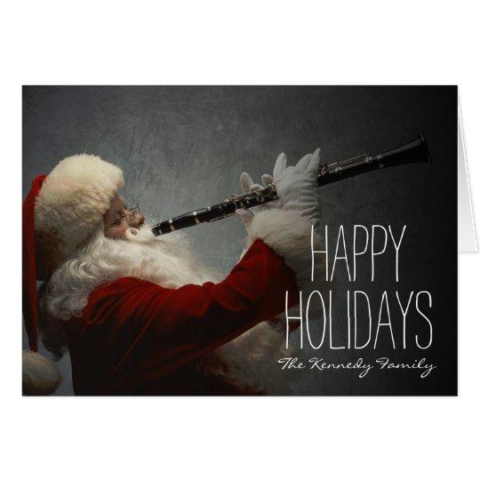 Weihnachtsmann, der Clarinet spielt Karte