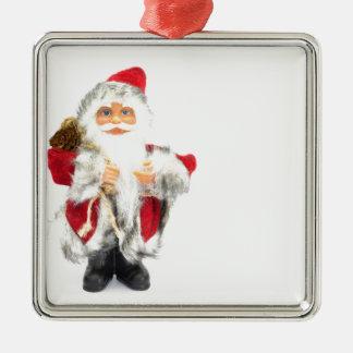 Weihnachtsmann-Figürchen abgeschieden auf weißem Silbernes Ornament