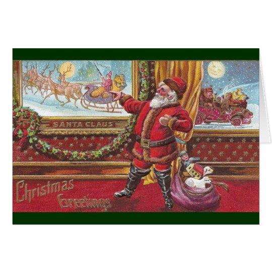 Weihnachtsmann zeigt stolz auf sein Porträt Karte