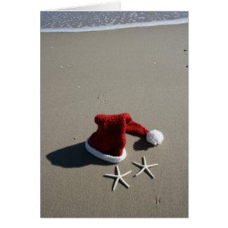 Weihnachtsmannmütze-frohe Weihnachten vom Strand Karte
