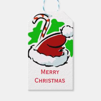 Weihnachtsmannmütze und Zuckerstange frohe Geschenkanhänger