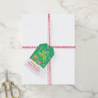 Weihnachtsren, das über Geschenkgrünrot tänzelt Geschenkanhänger