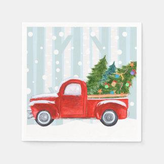 Weihnachtsroter Lieferwagen-LKW auf einer Papierserviette