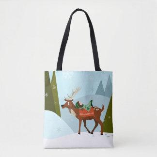 Weihnachtsrotwild und -elf auf schneebedeckten tasche