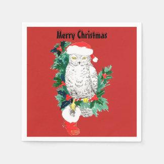 Weihnachtssnowy-Eule mit Weihnachtsmannmütze und Papierservietten