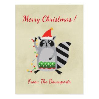 WeihnachtsWaschbär, der Feiertags-Lichter hält Postkarten