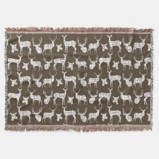 Weiße Rotwild auf Brown-Wurfs-Decke Decke