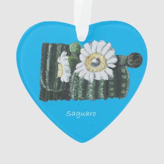 Weiße Saguaro-Kaktus-Blüten auf blauer Verzierung Ornament