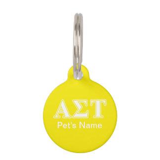 Weiße und gelbe Buchstaben AlphasigmaTau Tiermarke
