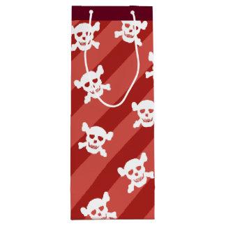 Weißer Totenkopf mit gekreuzter Knochen auf roten Geschenktüte Für Weinflaschen