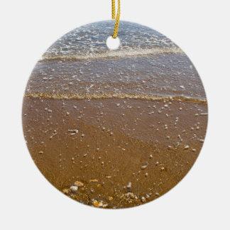 Wellen, die gegen Kiesel-Kreis-Verzierung spritzen Keramik Ornament