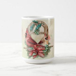 Winter-Kardinals-Paare mit Poinsettia Kaffeetasse