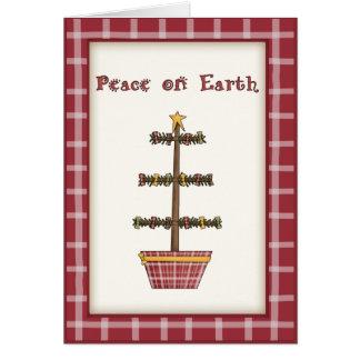 Wunderlicher Land-Weihnachtsbaum auf rotem Karte