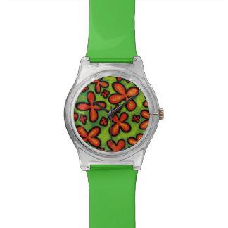 Wunderliches grünes und orange Blumen Uhr