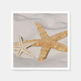 Zwei Starfish im Sand Papierserviette